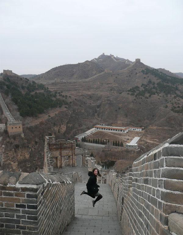 My fiancee jumping for joy after hitting 100,000 steps on the Great Wall. Photo taken by me in 2008.