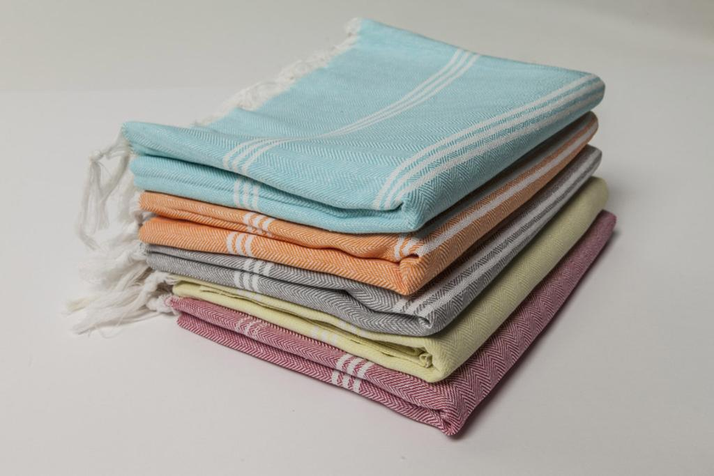 """OTTOLOOM ZANZIBAR TOWEL, $49.94: Okay, we're aware that a towel is an oddly unsexy choice for a present - but not when it's a pastel Turkish pestamel. These light towels are so chic (they look way better on a towel rail than your classic fluffy jobs); quick drying (they're perfect for the beach and gym) and are just as absorbent as classic towels. Your friend may be bewildered by the gift at first, but once she goes Turkish, she'll never go back to terry.  <a href=""""http://ottoloom.co.nz/collections/beach/products/zanzibar"""" target=""""_blank"""">Check it out here.</a>"""