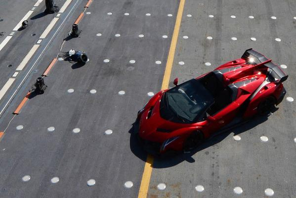 The Lamborghini Veneno Roadster makes its public debut on board the Italian naval aircraft carrier Nave Cavour in Abu Dhabi.