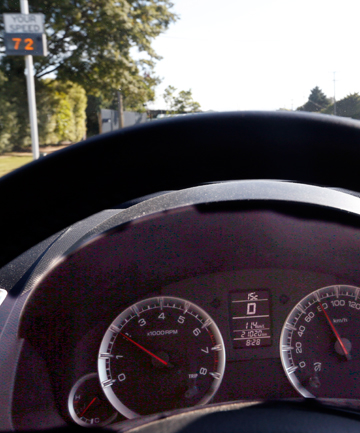 WARNING SIGN: : The speedometer on a 2012 Suzuki Swift shows 80kmh while a roadside speed display in Main Road Hope shows 72kmh.