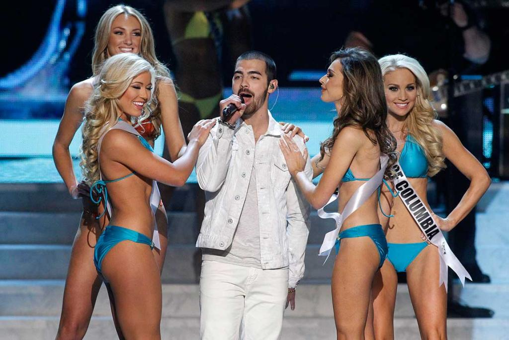 Joe Jonas (centre) performs during the Miss USA pageant.