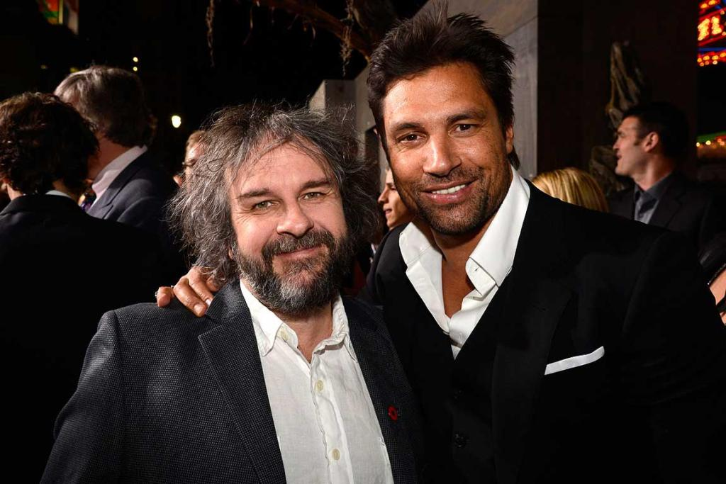 Peter Jackson (L) and cast member Manu Bennett at the premiere of The Hobbit: The Desolation of Smaug in Los Angeles.