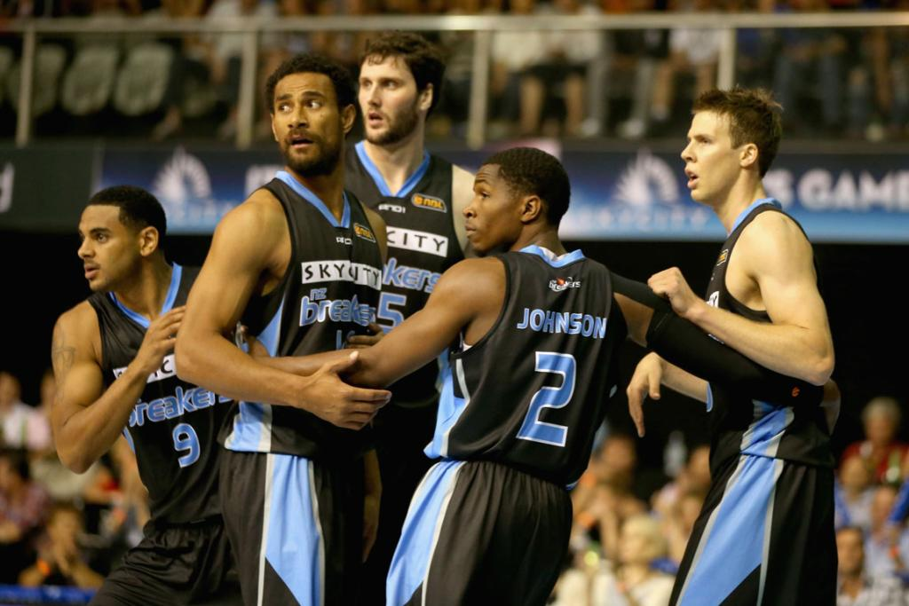 Corey Webster, Mika Vukona, Alex Pledger, Kerron Johnson and Thomas Abercrombie of the Breakers look to the bench for instructions as they gather together after scoring during the round eight NBL match between the New Zealand Breakers and the Melbourne Tigers,