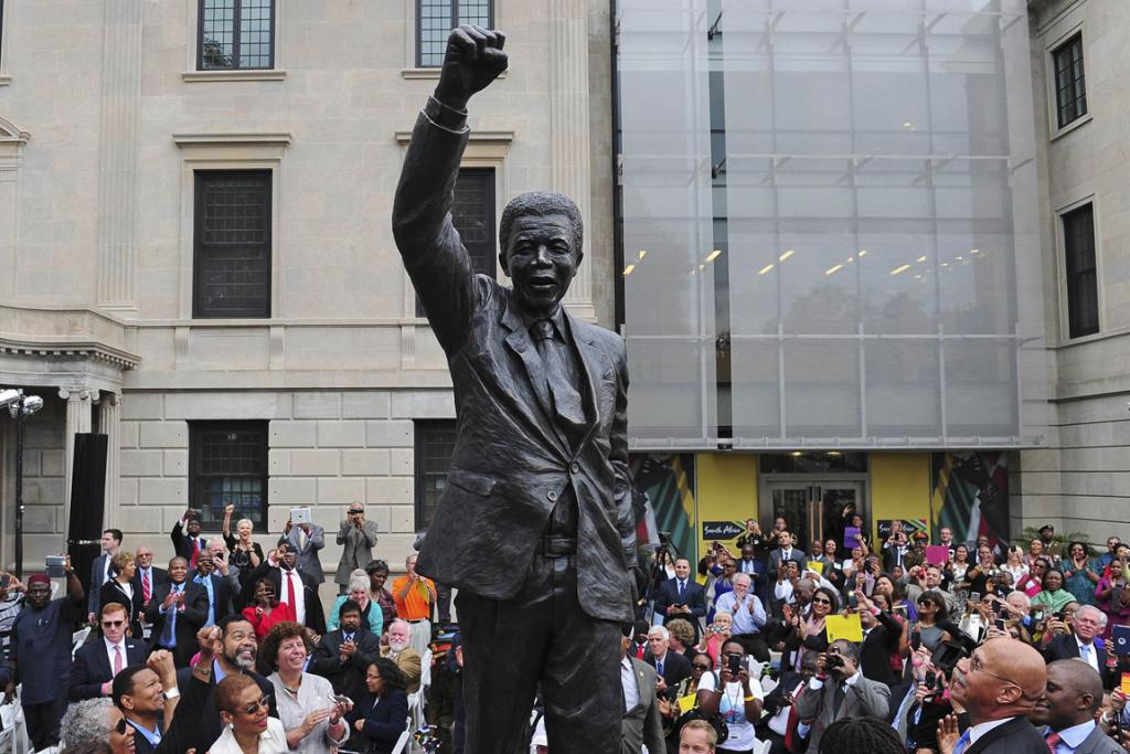A nine-foot statue of former South African President Nelson Mandela is unveiled outside South Africa's newly renovated embassy in Washington.