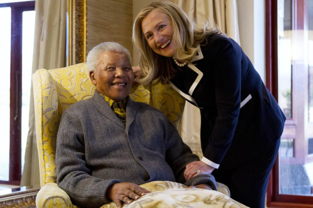 Then US Secretary of State Hillary Clinton meets with Nelson Mandela in 2013.
