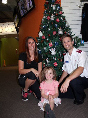 CHRISTMAS GIVING: Kali Brydon, Charlotte Elsmore, 4 and Salvation Army Hibiscus Coast corps officer Ben Schischka are hoping people will be generous during their Christmas toy appeal.