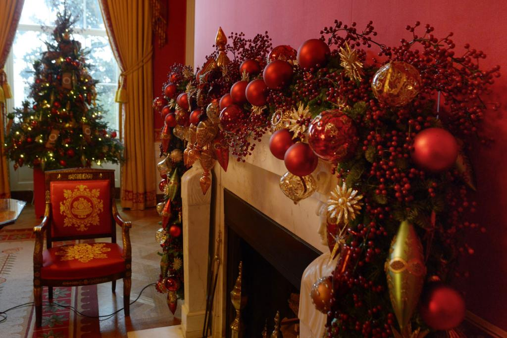 TRADITIONAL COLOURS: The White House's Red Room is fit for Christmas, with a little extra festive cheer added.