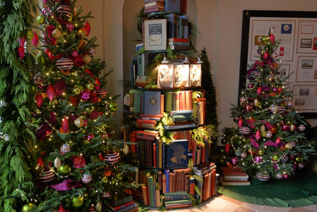 NATURE REVEALS: Among the Christmas trees at the White House is one made from books to reflect this year's holiday theme at the house: Gather Around, Stories of the Season.