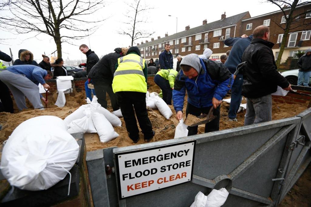 Residents fill sand bags before an expected storm surge in Great Yarmouth, eastern England.
