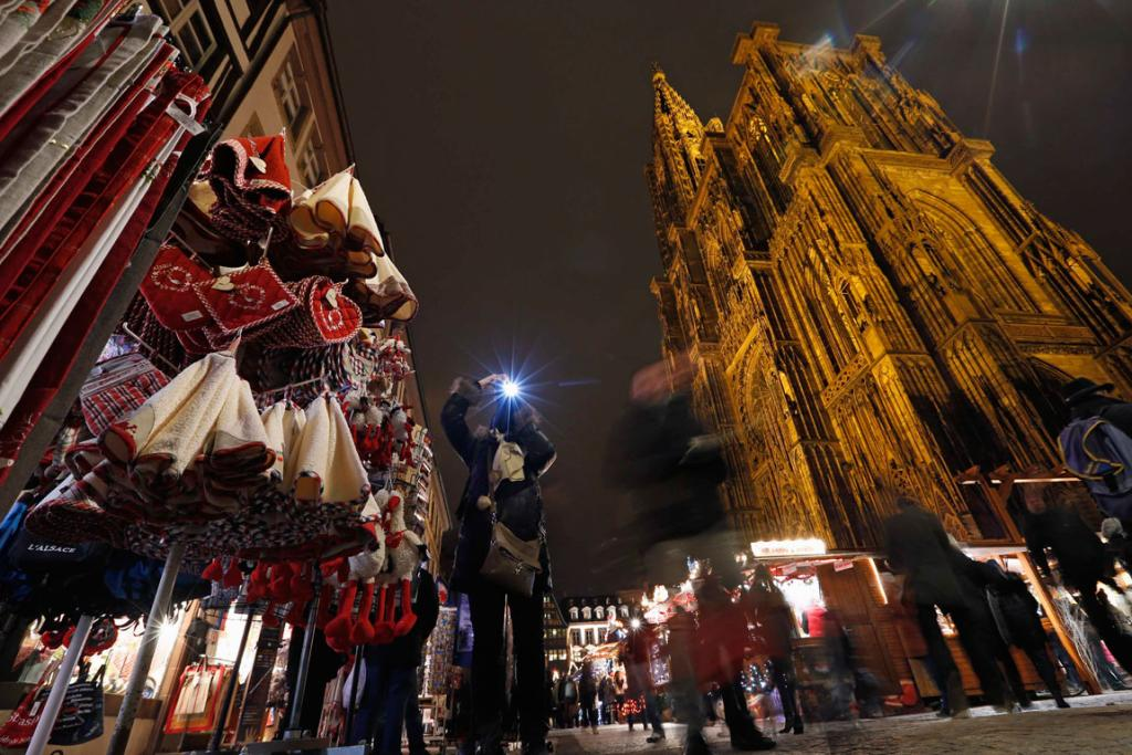 Tourists visit the traditional Christkindelsmaerik (Christ Child market) near Strasbourg Cathedral. Held annually since 1570, Strasbourg's Christ Child Market, known as the oldest French Christmas market, will be held until December 31.