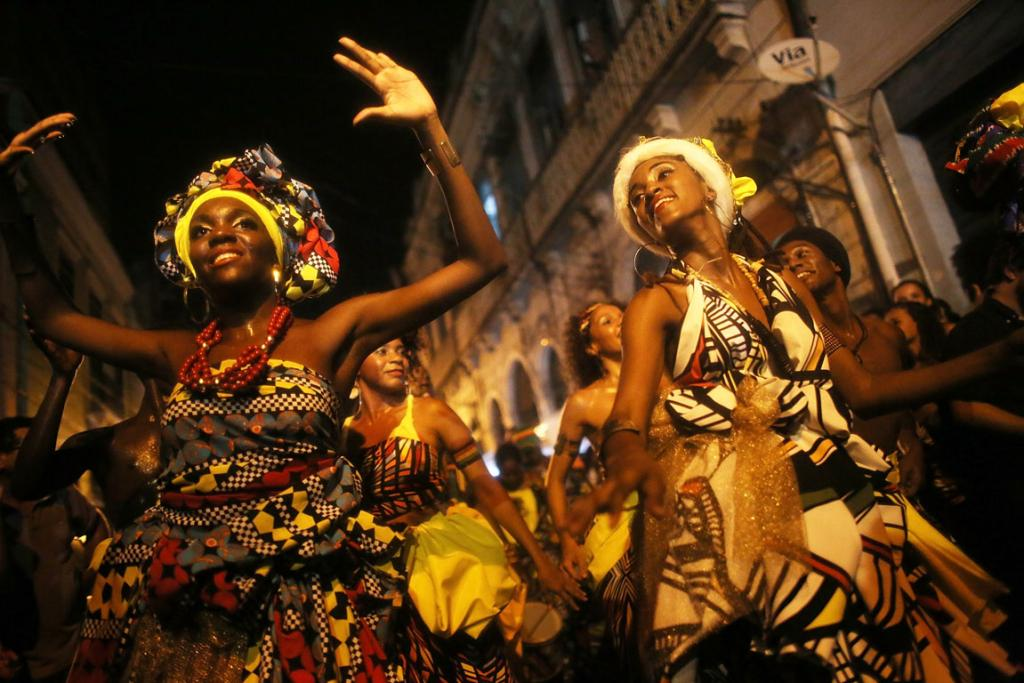 Performers from Grupo Orunmila dance at National Day of Samba celebrations at Pedra do Sal in the port district in Rio de Janeiro, Brazil.