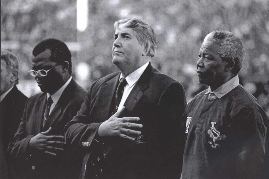 President Nelson Mandela, right, with Louis Luyt, centre, before the start of the 1995 world cup.