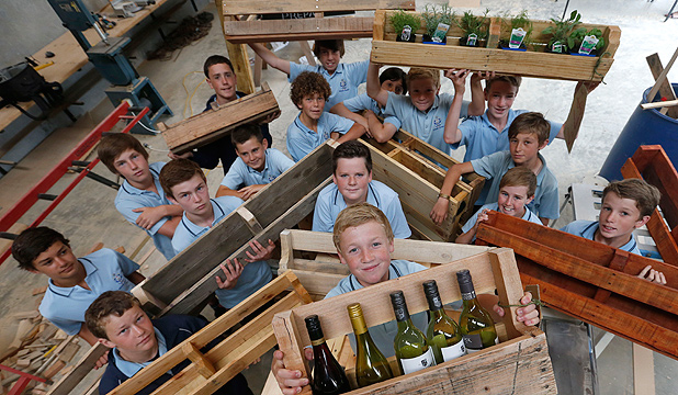 IN BUSINESS: Thomas Zohrab, centre, and his fellow year 7 and 8 Nelson College Preparatory School pupils with timber products they have made at the college from used pallets.