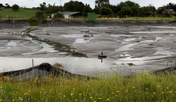 The covered pond in which the byproduct has been dumped