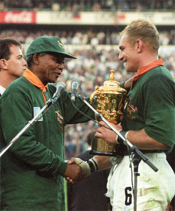 DEFINING MOMENT: Nelson Mandela presents Springboks captain Francois Pienaar with the William Webb Ellis Trophy following the 1995 Rugby World Cup final.