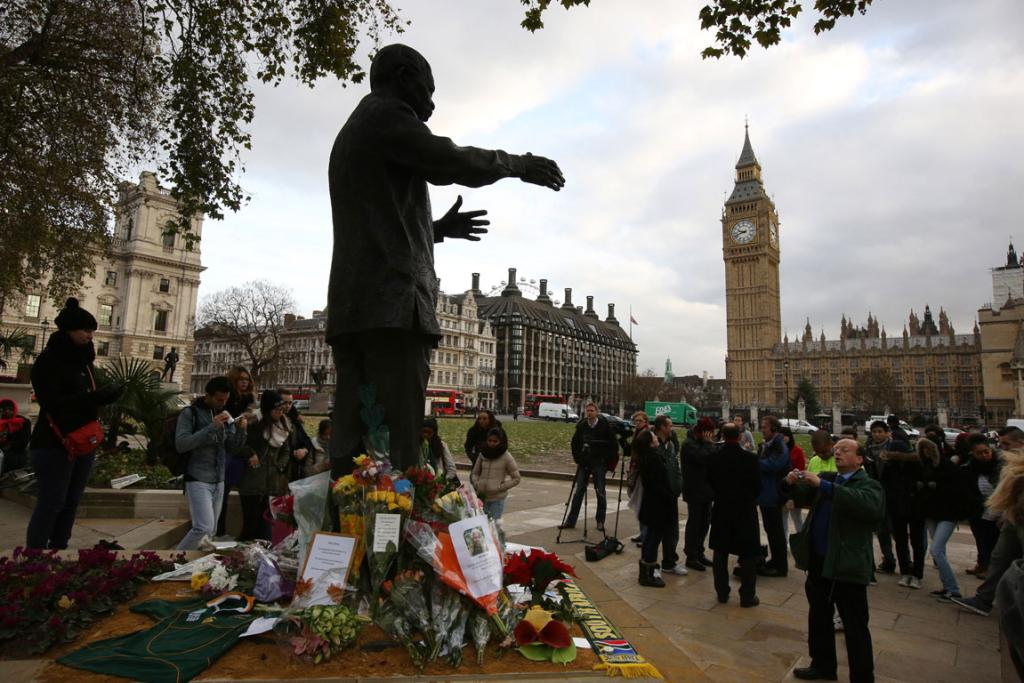 PARLIAMENT SQUARE: In London, in the shadow of Big Ben, floral tributes were laid at the base of Mandela's statue.