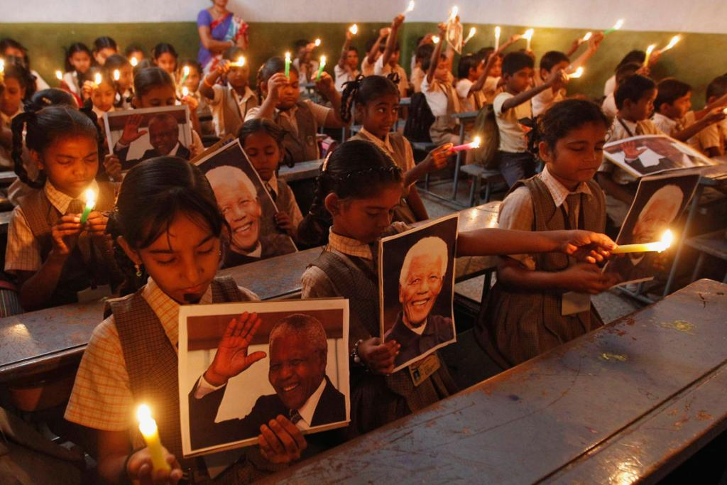 YOUNG TRIBUTES: A prayer ceremony was held at a school in the western Indian city of Ahmedabad.