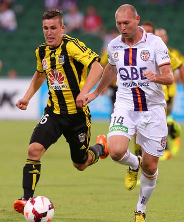 CHASE ON FOOT: Phoenix midfielder Louis Fenton chases down the Glory's Steven McGarry during their A-League match in Perth.