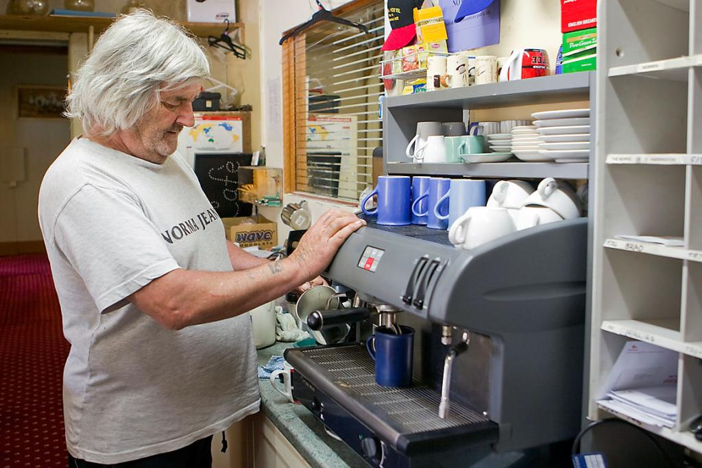 BUSY: Bill Hennah fires up the coffee machine at the Otira Hotel.