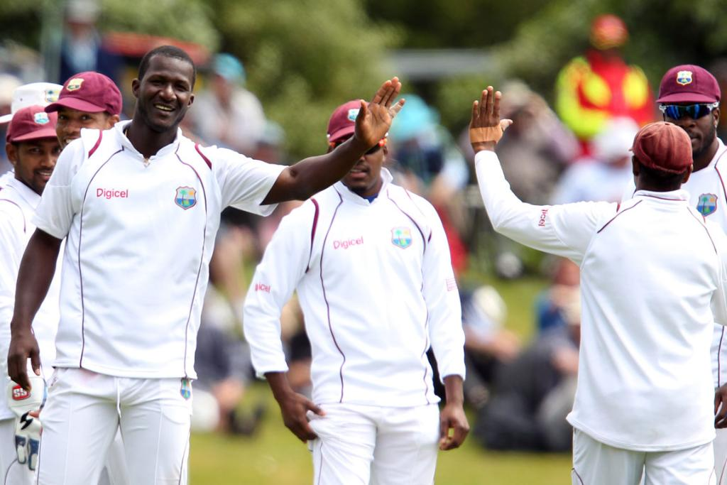 Darren Sammy of the West Indies celebrates taking the wicket of Peter Fulton.