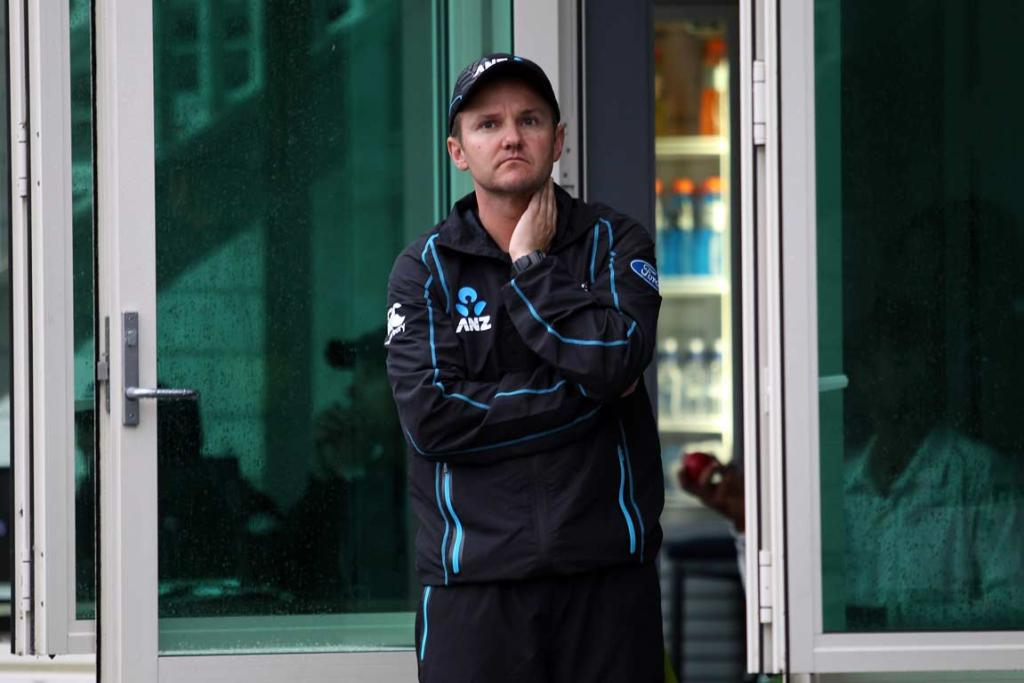 A dejected Black Caps coach Mike Hesson looks skyward in the hopes the rain will stop.