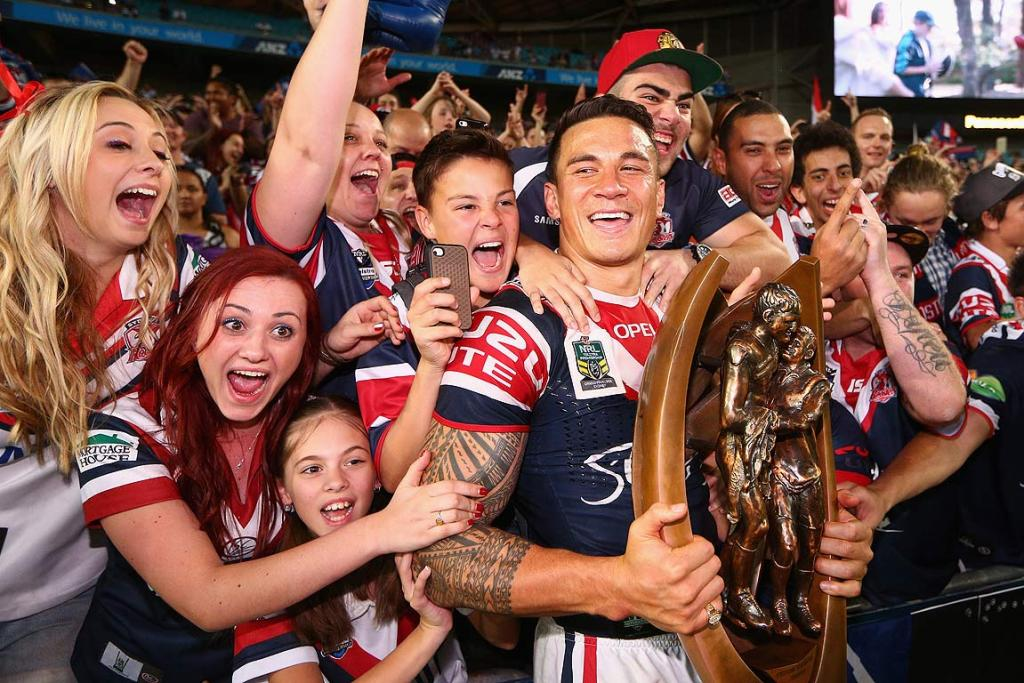 Sonny Bill Williams celebrates winning the NRL Grand Final with some ecstatic Sydney Roosters fans.