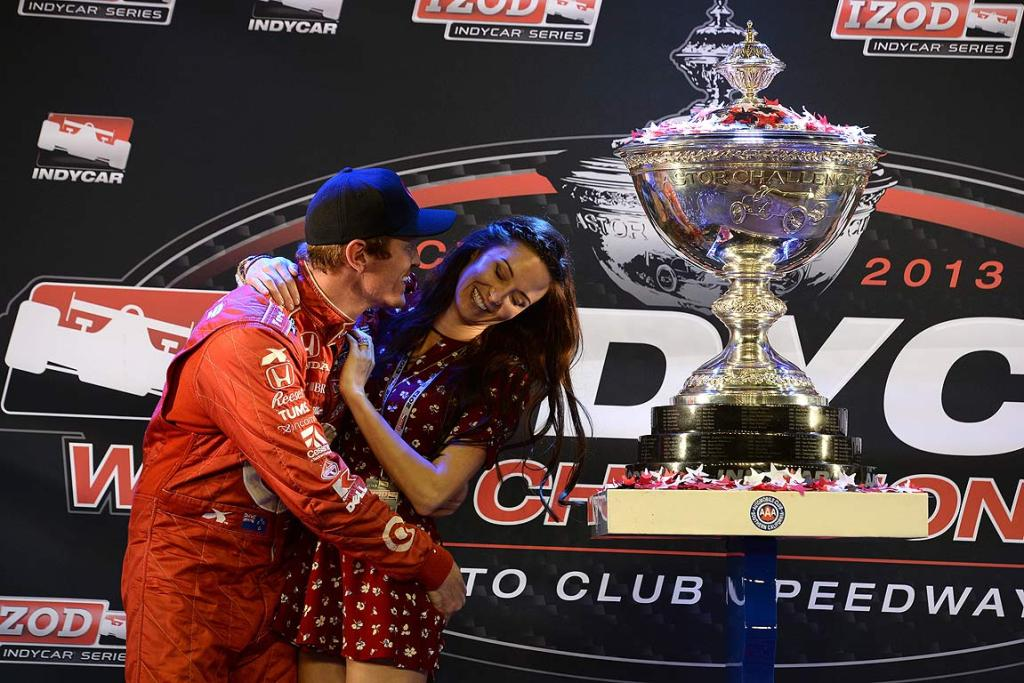 Scott Dixon kisses his wife Emma after winning the IndyCar championship.
