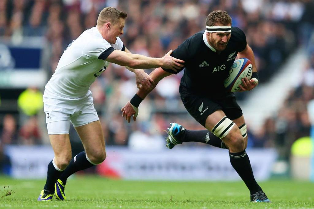 Kieran Read, right, evades the tackle of England's Chris Ashton as he inspires the All Blacks to a win in London.