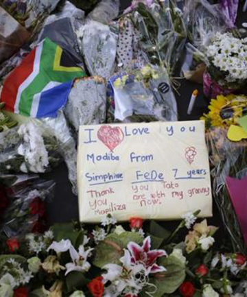GOODBYE MADIBA: Flowers and written tributes are seen at Mandela square in Johannesburg.
