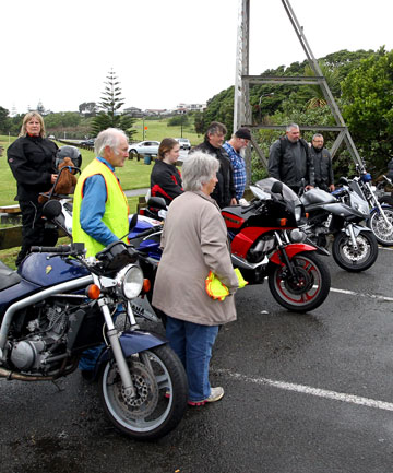 Rev Albie Martin prays for the safety of a group of 10 motorcyclists before they head out for the annual Round the Mountain Toy Run.