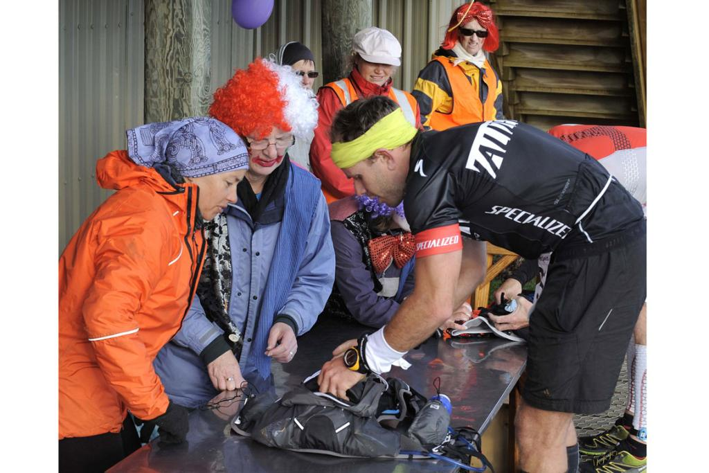 Flavio Vianna having his bag checked at the Luxmore Hut during the 2013 Kepler Challenge at Te Anau on Saturday.
