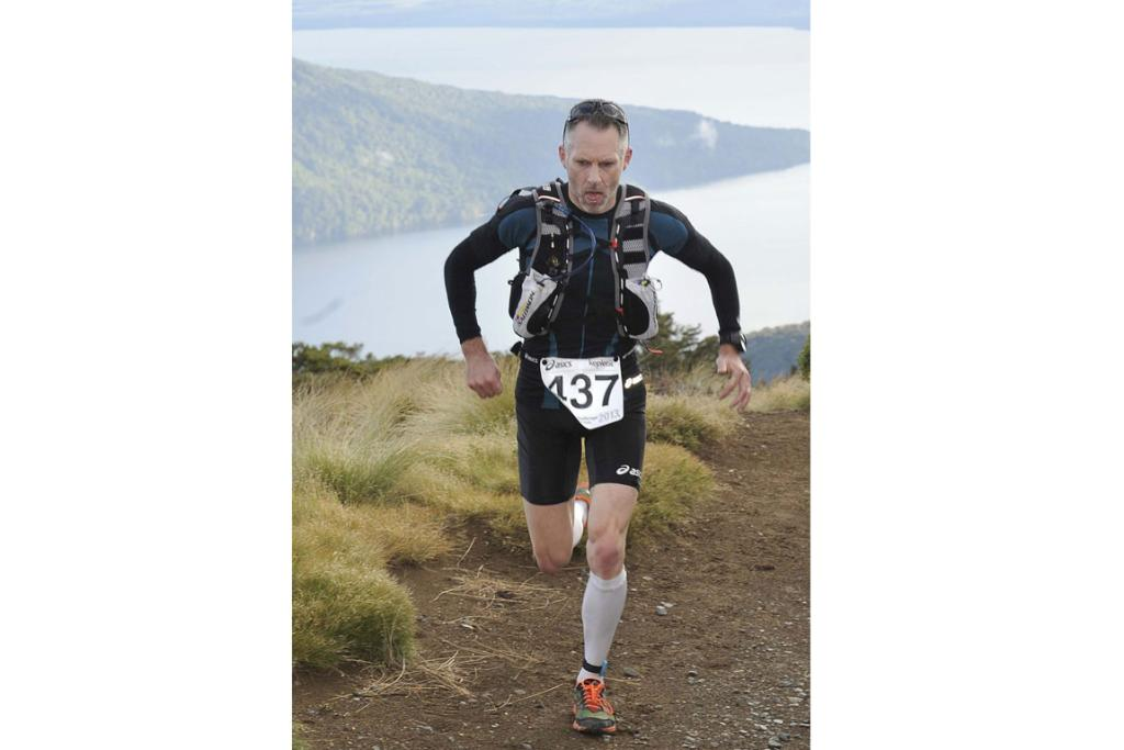Rowan Walker, of Canberra, heads towards the Luxmore Hut during the 2013 Kepler Challenge at Te Anau on Saturday.