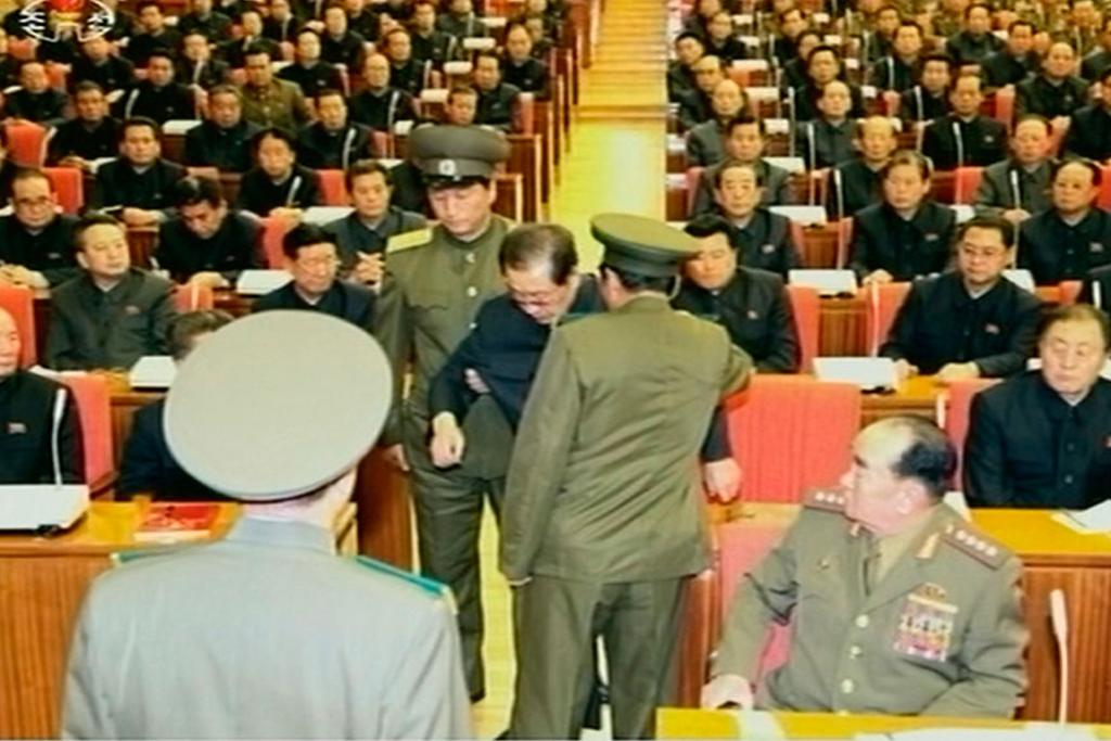 Jang Song Thaek being forcibly removed by uniformed personnel from a meeting of the Political Bureau of the Central Committee of the Workers' Party of Korea.