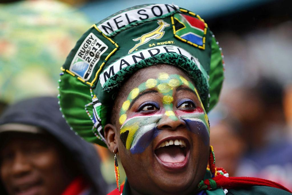 CELEBRATION OF A LIFE: People start singing as they arrive for a mass memorial for Nelson Mandela at First National Bank Stadium in Johannesburg.