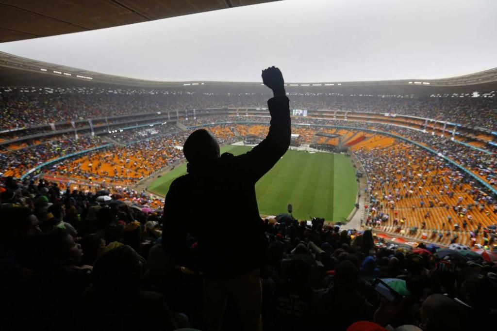 A mourner pumps his fist during the Nelson Mandela memorial in Soweto.