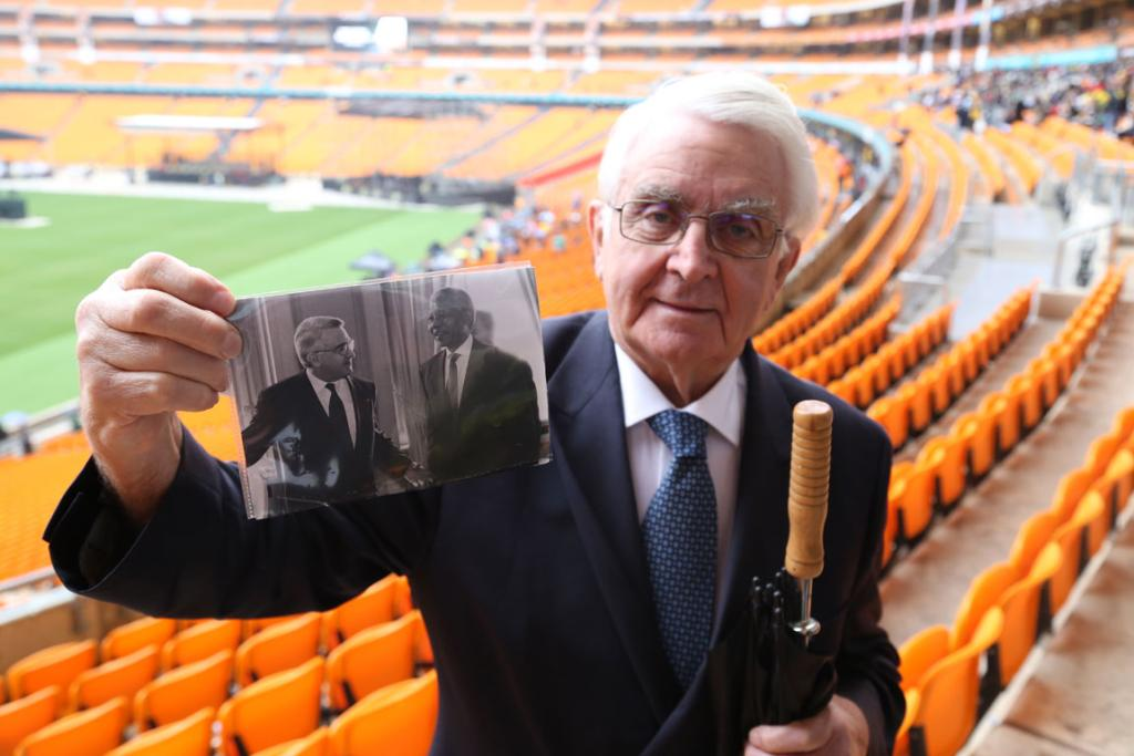 J. Nico Scholten, from Amsterdam, holds up a photo of his meeting with Nelson Mandela.