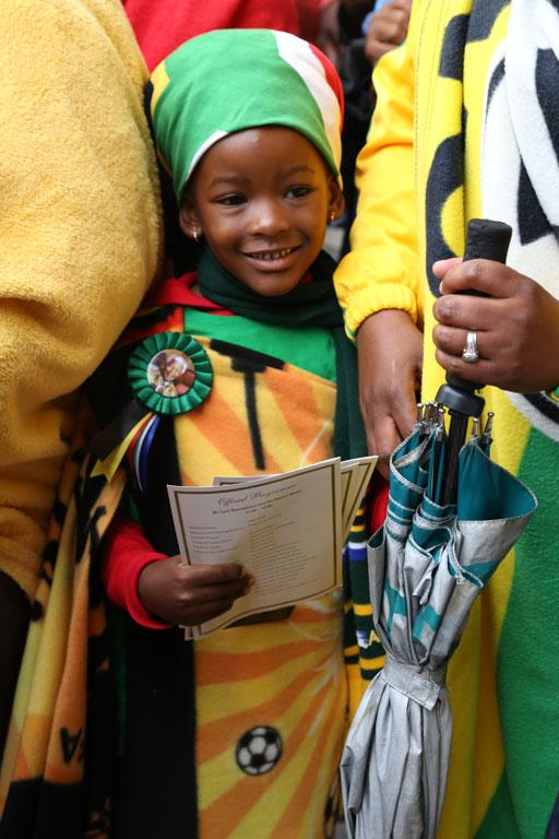 A child draped in a South African flag at Soccer City stadium for Nelson Mandela's memorial.