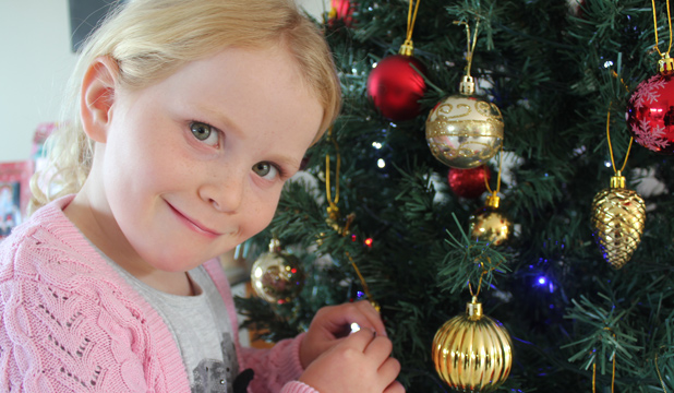 SWITCH FLICKER: Hannah Underwood, 6, has been practising turning on Christmas tree lights at home before her big moment at the Coca-Cola Christmas in the Park on Saturday night.