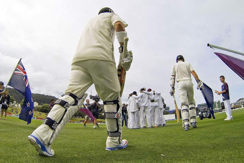 Hamish Rutherford, left, and Peter Fulton of New Zealand take the field in Wellington.