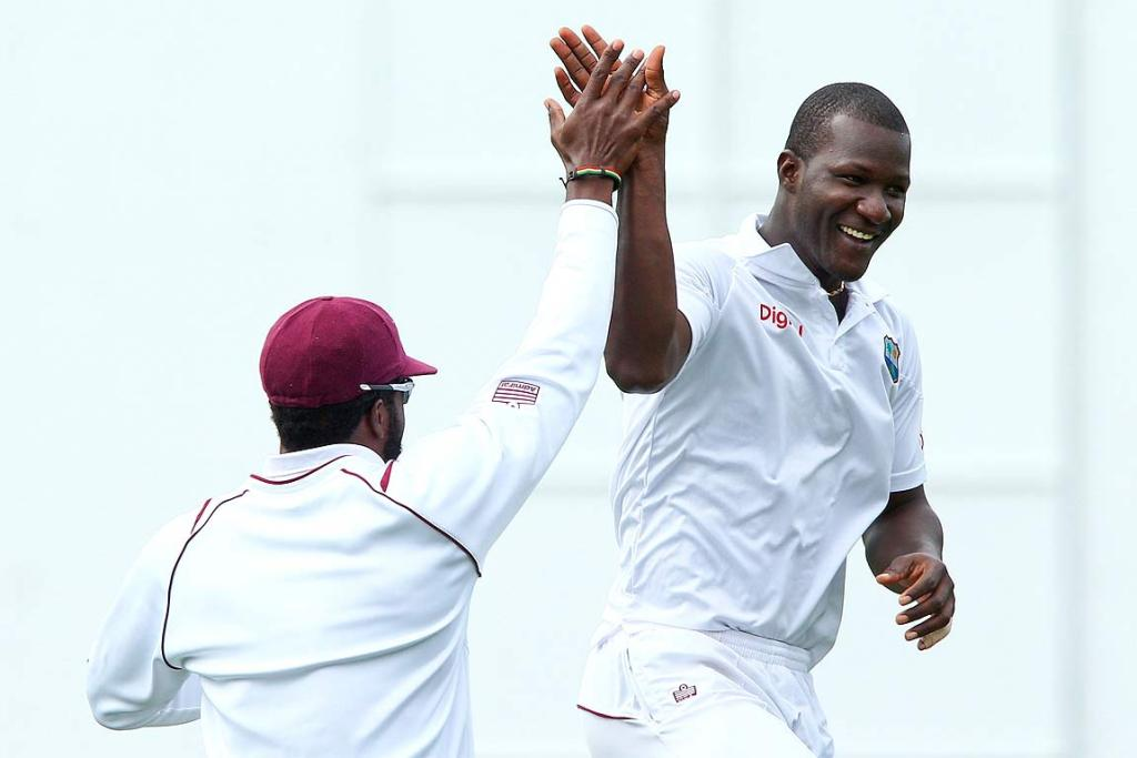 Darren Sammy of the West Indies celebrates after taking the wicket of Peter Fulton.
