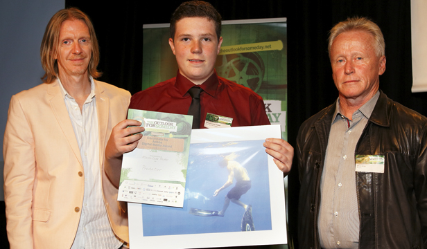 Proud moment: Mason Cade Packer with his award, presented by film-maker Andrew Adamson, left, and Chris Gray, of Adobe.
