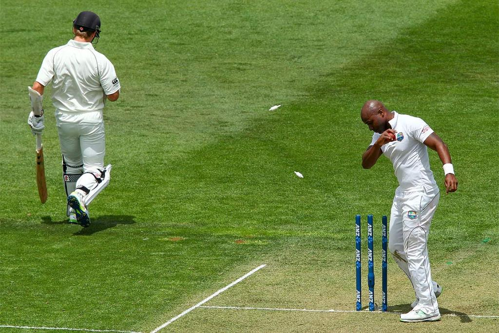 Tino Best of the West Indies knocks the bails off the wickets as Kane Williamson makes his ground.