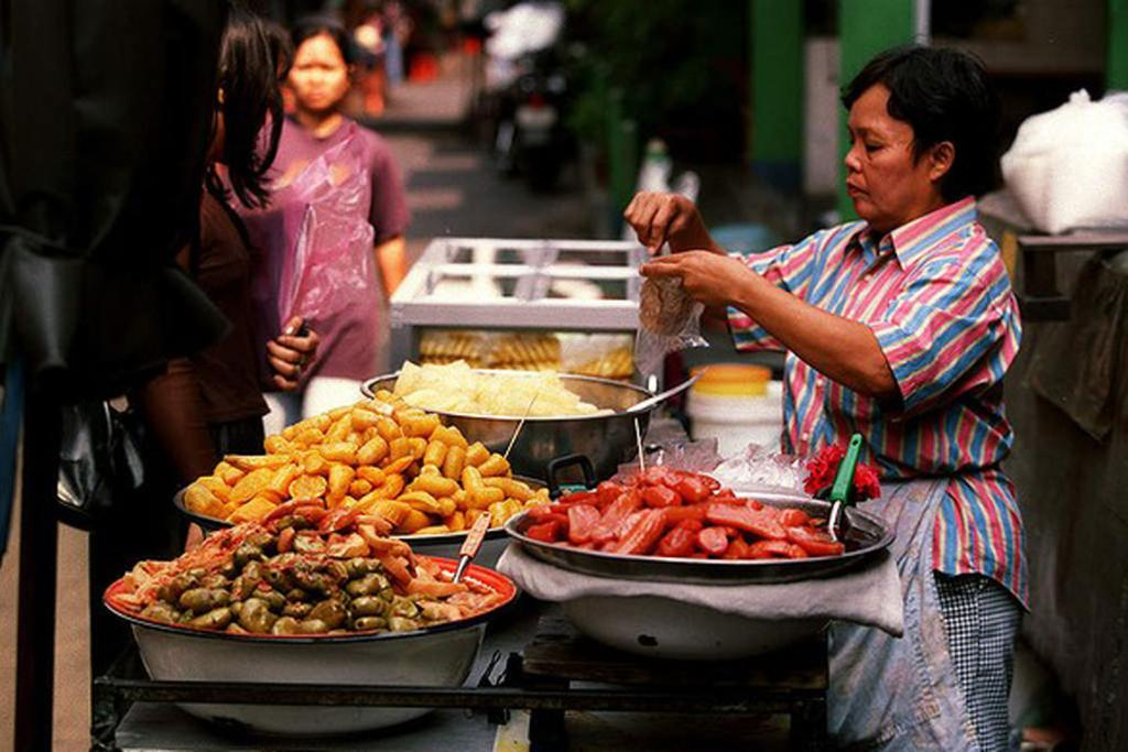Street food in Bangkok, Thailand. Don?t ask what it is ? don't even try to figure it out. Just gorge yourself on everything Bangkok street vendors have to offer.