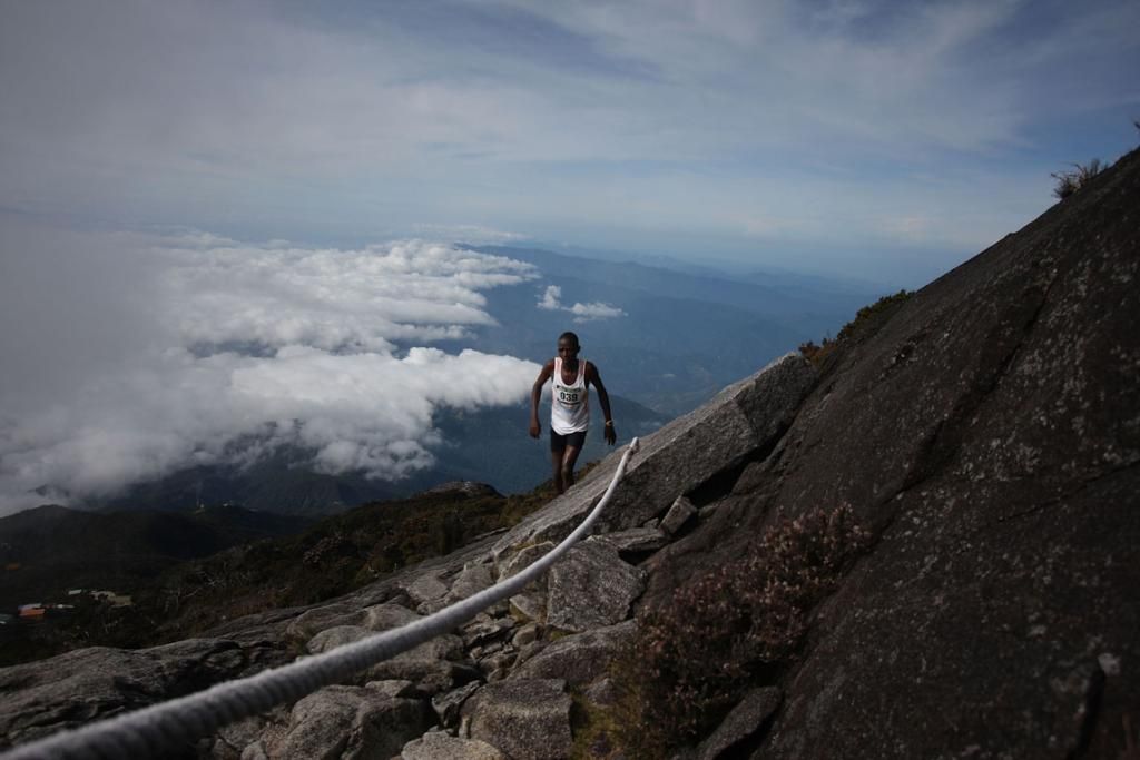 Climb Mount Kinabalu, Borneo, Malaysia. The via ferrata here is not for the faint-hearted but it's an experience you'll never forget.