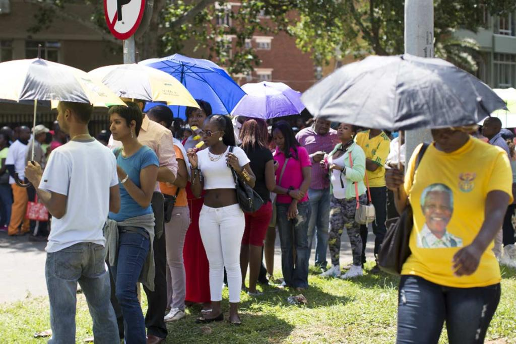 South Africans wait in line to pay respects to Nelson Mandela's body in Pretoria.