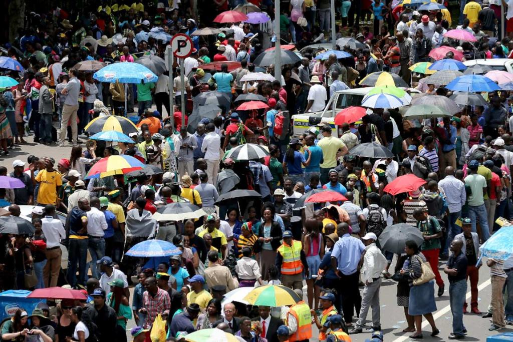 Thousands of South Africans wait in line to pay respects to Nelson Mandela's body in Pretoria.
