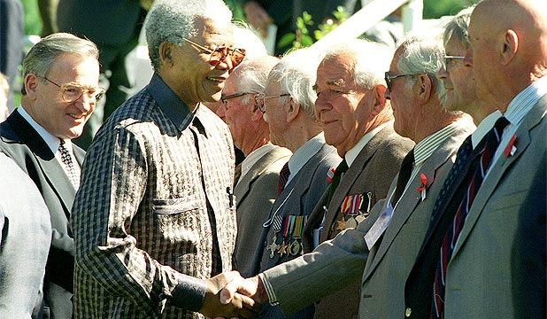 MANDELA IN NZ: Former PM Jim Bolger follows Nelson Mandela as he meets RSA members in Arrowtown at the Commonwealth Heads of Government meeting in 1995.