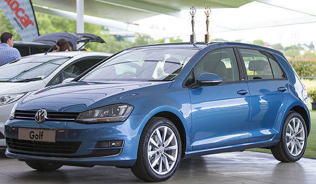 The Volkswagen Golf with trophies for winning compact car of the year and the overall NZ Autocar Car of the Year titles.