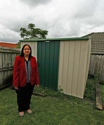 TOO CLOSE: Rashna Tata says if her shed is legally placed it will be in the centre of her backyard, if it fits at all. ''It has to be on the boundary, where else can it go?''
