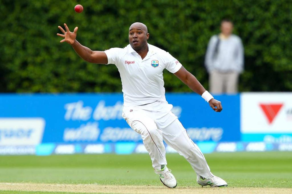 West Indies bowler Tino Best fields the ball off his own bowling.